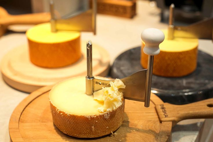 Boska Cheese curler in wood or marble shaves a thin twisty layer off any semisoft cheese. Party needed!