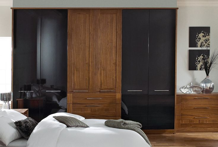 Contrasting black and brown bedroom furniture is an accessible way of creating a dramatic interior