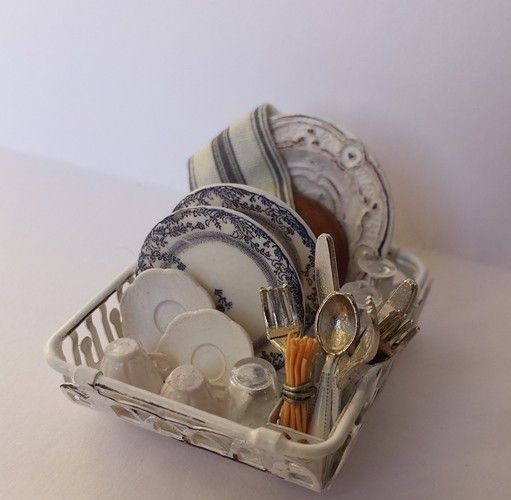 Miniature dish rack with clean dishes...