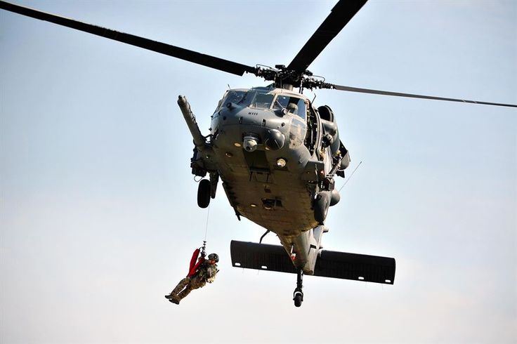 An Air Force pararescueman fast-ropes from an HH-60 Pave Hawk helicopter during a personnel recovery demonstration at Francis S. Gabreski Air National Guard Base in Westhampton Beach, N.Y., Sept. 10, 2016. The airman is assigned to the 103rd Rescue Squadron and the helicopter crew is assigned to the 101st Rescue Squadron. Air National Guard photo by Staff Sergeant Christopher S. Muncy