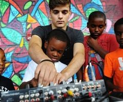 Aww! Wait what's he doing? DJing for poor children HOLY OKAY I LOVE YOU MORE NOW