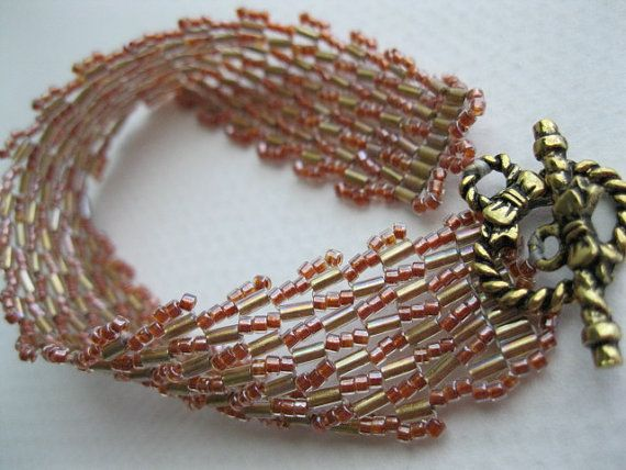 Persimmon and gold Cleopatra band by BeadALittleDream on Etsy, $17.00