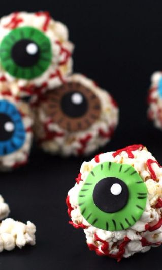 Popcorn Eye Balls-We've got our eye on you with these creepy, bloodshot Popcorn Eye Balls. Trick-or-treaters will screech with delight when they take a bite out of this sweet and crunchy party treat made with candy melts. They would be so fun to serve in a big bowl staring up at all your guests at a Halloween party. They are also perfect for gift giving - just wrap em up in clear bag and tie with some ribbon. You're friends, family and teachers won't give you the evil eye if you treat them…