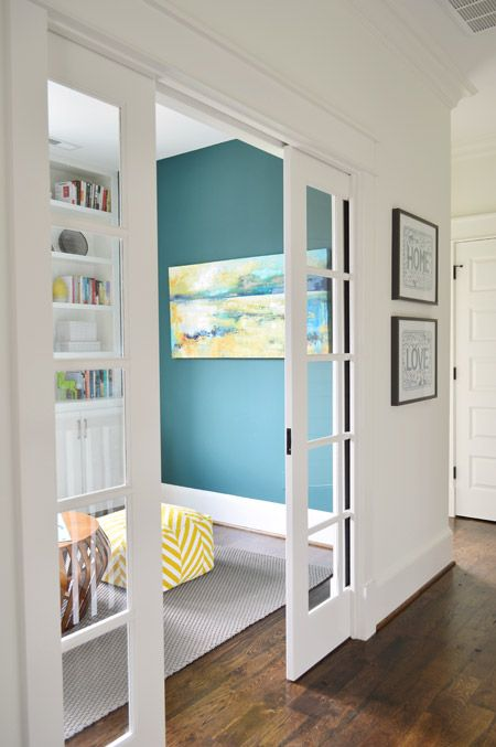 pocket doors for a playroom just off of the main family room, keep eye on kids nearby (Young House Love)