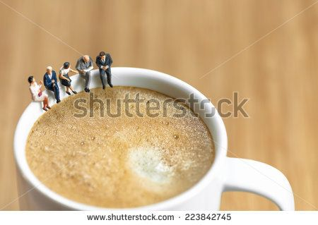 Miniature business team having a coffee break. Macro photo