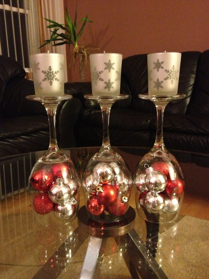 DIY Christmas decorations  Upside down wine glass..dollar store, mini ornaments...dollar store & votive and candle