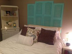 DIY shutter headboard -- cheap, plastic shutters from Home Depot + a little paint (used a light coat to create a more worn, rustic, imperfect look) + a few nails = wah-lah!