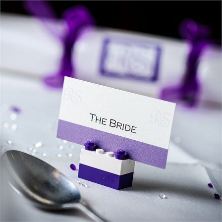 Lego place card holders had been designed to add colour to the reception tables. Sarah and Robert's wedding guests got a taste of the purple wedding colour scheme during the cocktail ...