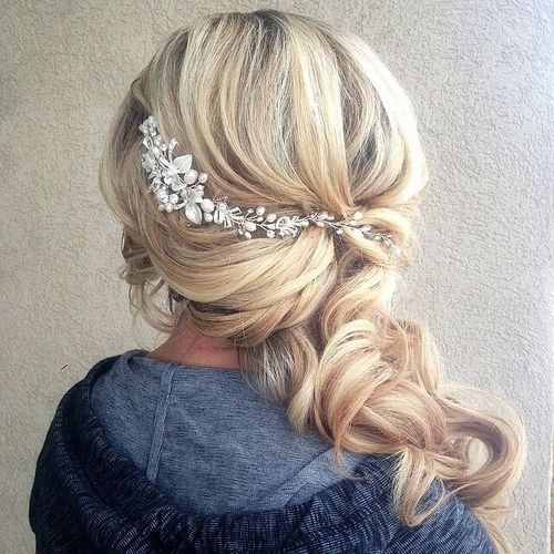 something like this might look nice in your tousled side due @tareeelaine (Wedding Hair Ponytail)