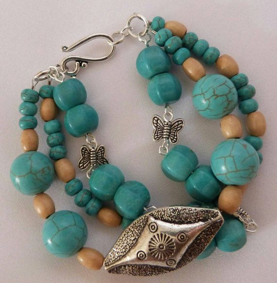 Check out this item in my Etsy shop https://www.etsy.com/au/listing/243072806/a-triple-strand-turquoise-and-wood-beads