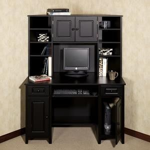 """""""Auston Black Corner Desk with Hutch. For living room."""" Okay so maybe not exactly this but I like how the desk is angled, and also if you only wanted one desk but also bookshelves, you could opt for something like this.  I think you could also easily make something like this if you don't want to buy it by putting together a simple desk and finding a bookshelf that fits it"""