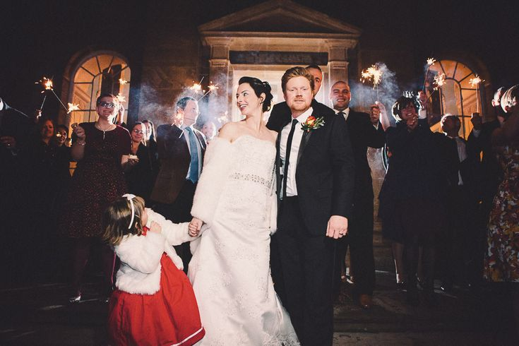 Kings Weston House wedding. Sparklers on the steps - Christmas wedding by Kevin Belson Photography. http://kevinbelson.com  Tel: 07582 139900 or 01793 513800 or email: info@kevinbelson.com