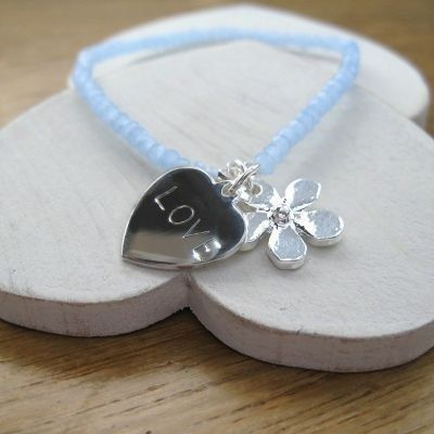 Give your bridesmaids a lasting memory of your wedding day with the Daisy Heart Charm Bracelet. The heart is engraved with a name or a little message for a unique gift they will always treasure. #Bridesmaids #Jewellery #PersonalisedGifts #Wedding  £16.99