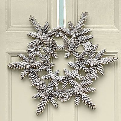 Snowy Pinecone Wreath | Long, slender pinecones, such as those of a white pine, work best for this new take on a Southern holiday classic—the pinecone wreath. Finish with a narrow ribbon layered on top of a wider ribbon.