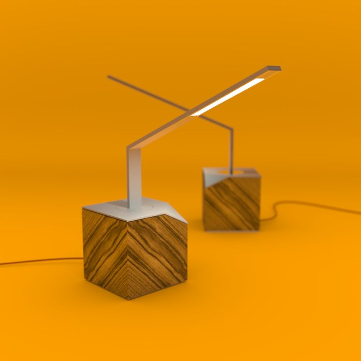 Desk Lamp Bird, a LED lamp with aluminium structure and olive wood base. Ideal for offices as well as for living spaces.