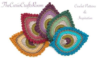 The Curio Crafts Room - Peacock Feather Applique (Above) is on Ravelry for $3.50 (she also has a mini one that's free - this link)