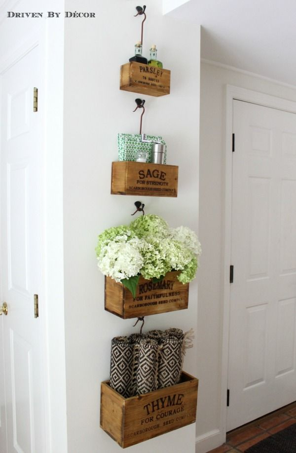 Wall mounted crates in our kitchen eat-in area hold all of our most used tabletop items