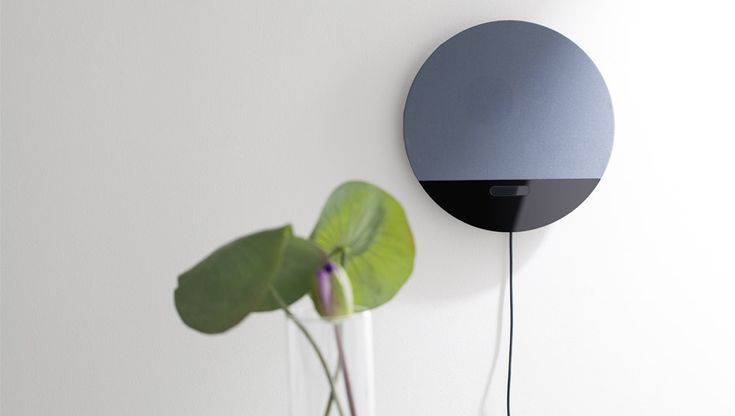 The Osound Bluetooth Speaker is a designer  wireless speaker that is shaped like a 'sunrise'.  It comes in several color combinations and looks amazing on the wall!