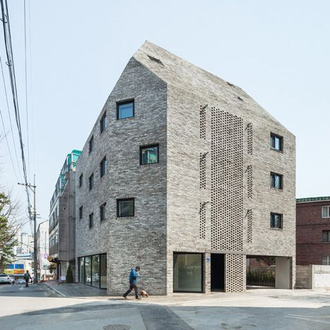 This apartment block in Seoul by South Korean designers OBBA has a semi-outdoor stairwell screened behind a section of open brickwork in the centre