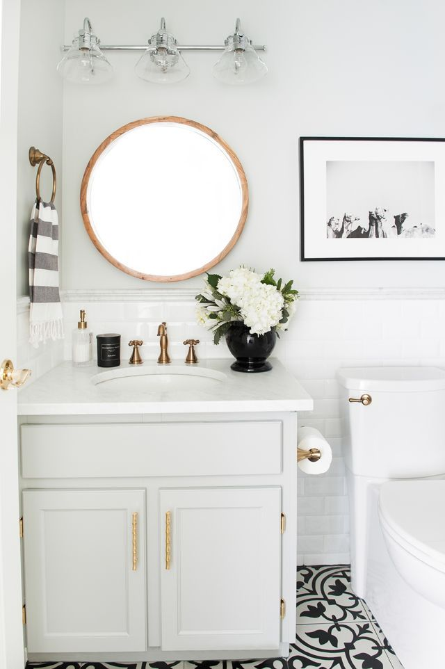 Marcus Design Before & After main bath reno with @deltafaucetcan fixtures in bronze and @minted artwork (photo by @traceyayton )