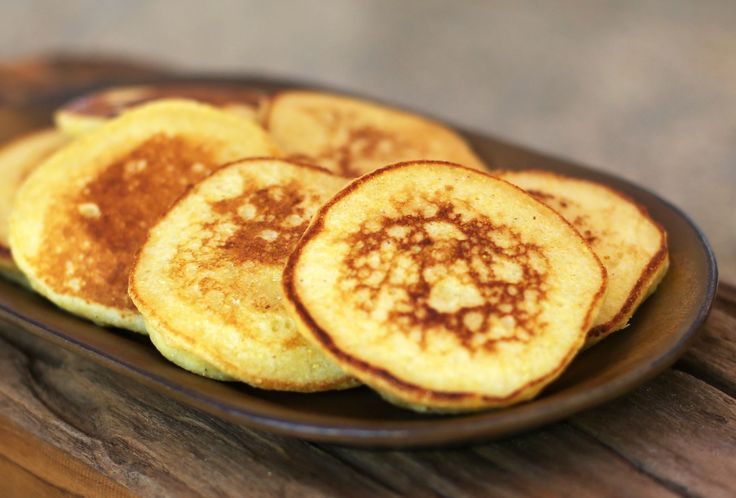 These johnnycakes are similar to cornmeal pancakes. The flat cakes are lightly sweetened and served with syrup or serve them as a savory bread.