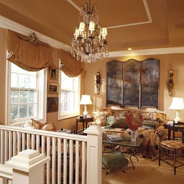 Consider an Elegant Tray Ceiling OR you could paint a stripe or add molding  to give