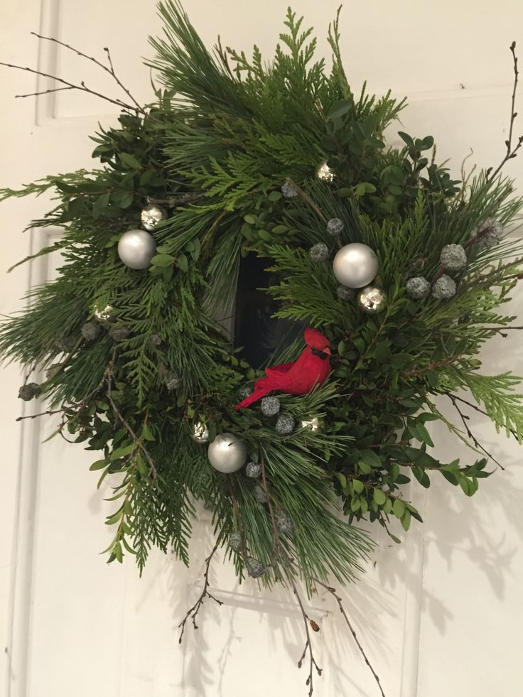 Front Door Wreath, hand tied with fresh greenery, glass ornaments, and a red cardinal. Designed by Sharlene Nielsen www.frontdoorstories.com