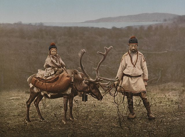 Boy seated on a reindeer in Finland- 1890-1900, by the National Library of Norway, via Flickr.