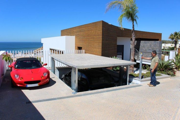 Car lift with sea view...wonderful villa in #Portugal with hidden parking garage! #carlift #idealpark #seaview