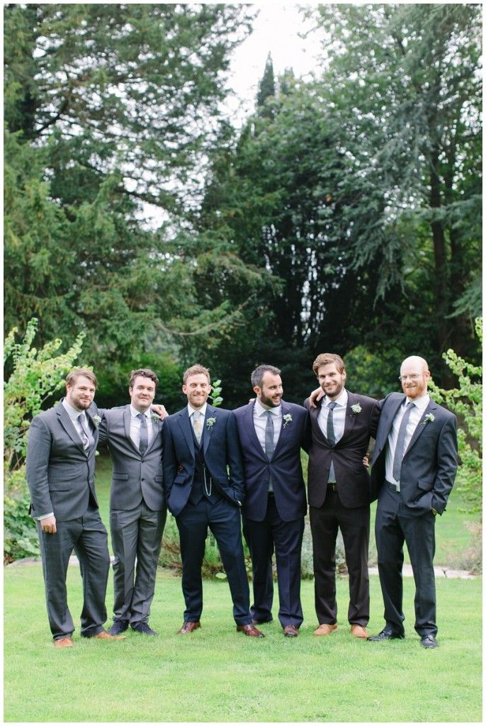 groom and ushers in mismatched suits