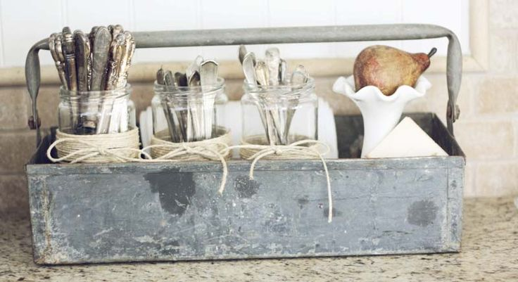 Vintage tool box and old silverware...perfect mix~