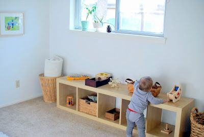 Montessori Bedroom for a One Year-Old - limited amount of toy arranged on a child sized shelf, not thrown in a bin.