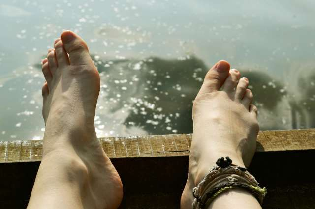 bare feet by the lake