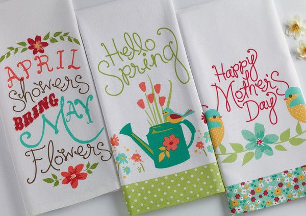 April Flowers Printed Dishtowel. April showers bring may flowers! Cheerful floral aprons, dishtowel sets, bird embroidered tea towels, printed shopping totes, and ceramic flower pots. Perfect Spring gifts and decor for the kitchen & home.