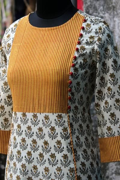 an a-line dress with a striped yoke & mangalgiri side potli! main fabric: 100% cottonhandblock printed using natural dyes from bagru, rajasthan. trims &a