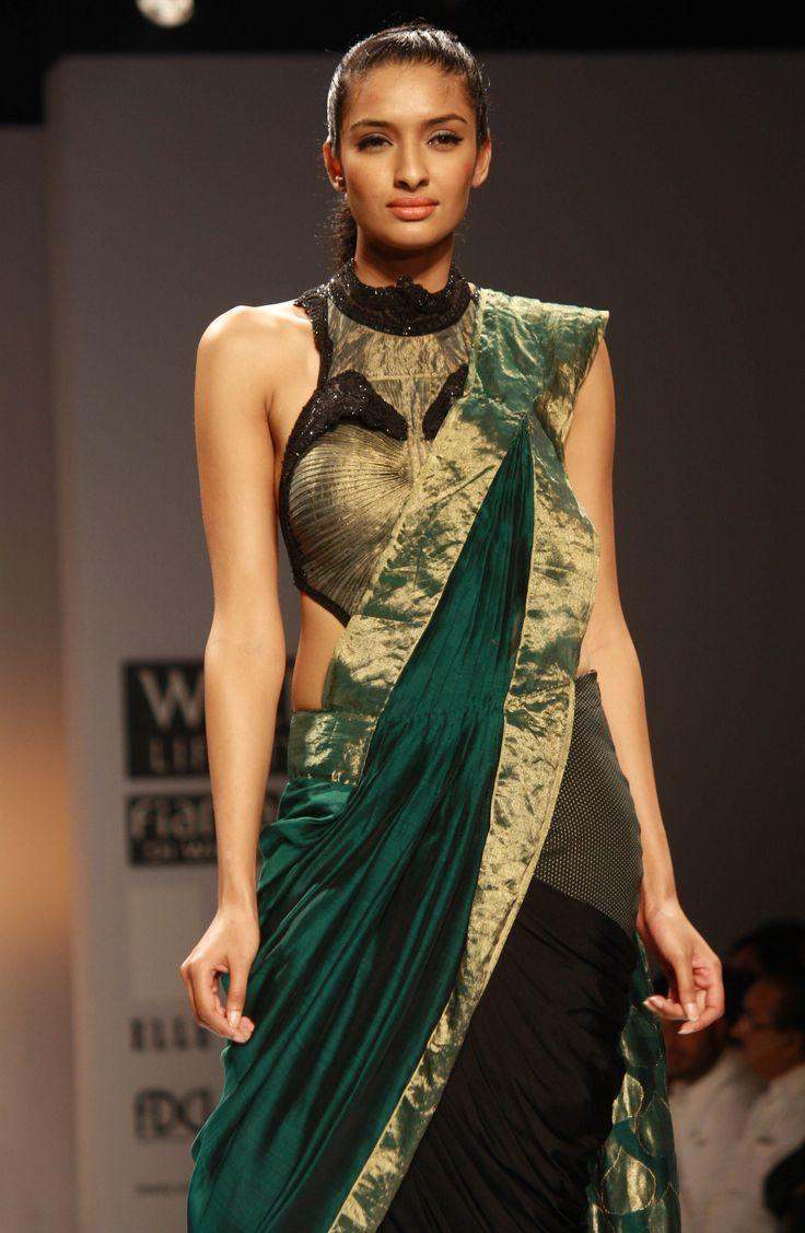 Models walk the ramp designer Sulakshana at Wills Lifestyle India Fashion Week 2013.