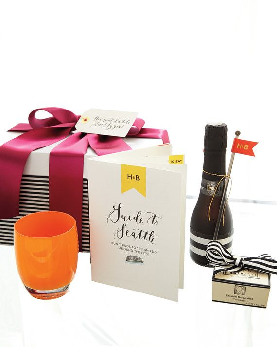"""Seattle-themed welcome boxes included a locally made votive holder; the couple's guide to the city; two mini bottles of Champagne; hand-colored chocolates with a note saying, """"How sweet it is to be loved by you""""; an in-palette Glassybaby candle holder, and a Starbucks card to use at Pike Place, the chain's first store."""