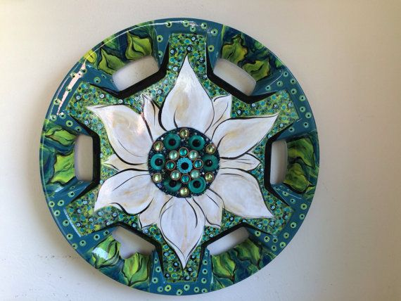 I love making custom Blooming Hub Caps. Let me know what type of creation you would like for your home or to give as an eco-friendly gift!  The easiest way to see the variety of colors and styles I make is to look at photos on the Blooming Hub Cap Facebook page. Send me an email and we can get the conversation started.  I have made custom orders that were sports and college themed, personalized gifts for wedding and new baby presents plus many where the customers told me the color scheme…