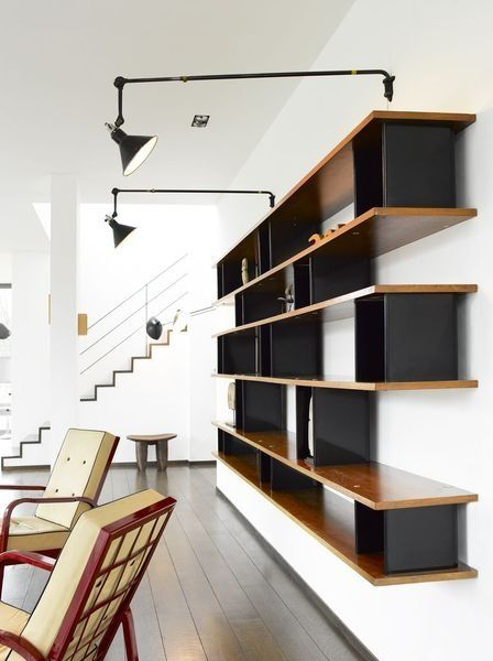 scandinaviancollectors:  An important and personal bookshelf by Charlotte Perriand, designed for Serge Mouille 1959. Edition Steph Simon. Material veneered walnut and lacquered aluminium. Provenance: From the personal collection of Serge andGin Mouille. Sold at Artcurial for286,451€, May 2012. / Artcurial