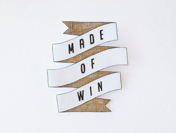 i think everyone needs something this awesome to wear.  Made of Win brooch, by rareindeed on Etsy