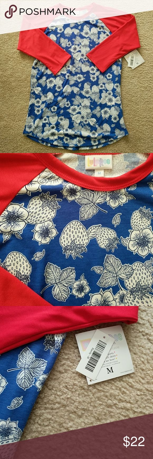 Lularoe Randy- red white & blue summery strawberry Lularoe Randy top size medium. Summery, with strawberry and flower pattern. Blue and white body with red collar and sleeves. Brand new with tags. LuLaRoe Tops Tees - Short Sleeve