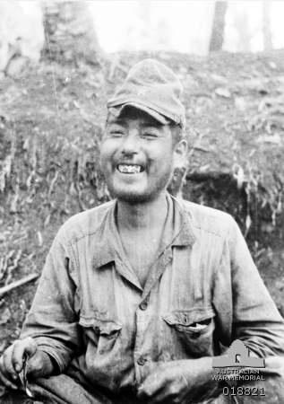 Maprik Area, New Guinea. 1945. Portrait of a smiling Japanese soldier after being taken prisoner at Ulebilum.