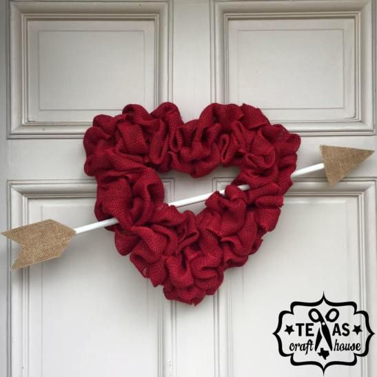 DIY Heart Burlap Wreath - Playful way to add a little love to your front door! This step by step craft how to includes helpful step photos and good tips for working with burlap. Love the trendy arrow, too! Fun DIY wreath project for Valentine's Day or even Fourth of July! From Texas Craft House!