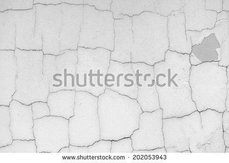 Grey concrete wall with cracks - stock photo