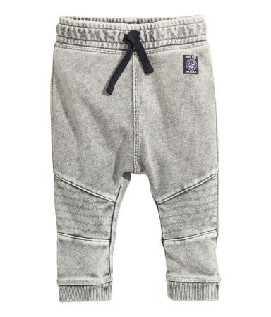 Gray. Joggers in soft, washed sweatshirt fabric with an elasticized drawstring waistband. Back pocket, dropped gusset, and tapered legs with decorative