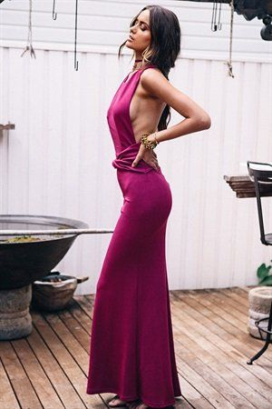 Add a touch of elegance to your evening in the floor length Ophelia Gown. Made from a heavy, textured fabric in a magenta hue, it features a high rounded neckline, twisted draping waist detail and sultry low back. Semi-fitted design. Finish off the look with gold bangle stack, strappy nude heels and loosely pulled back hair! Exclusively designed by Sabo Skirt for SABO FORMAL.
