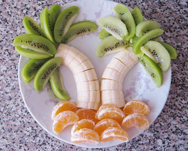 Banana palm tree with kiwi and oranges
