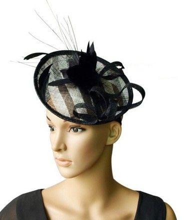 """Boucle"" Black and White Fascinator. A beautiful design of sinamay curls, a spray of feathers and floral centerpiece sitting on a circular base atop a satin headband. $79.95 including gift box and FREE shipping in Australia."