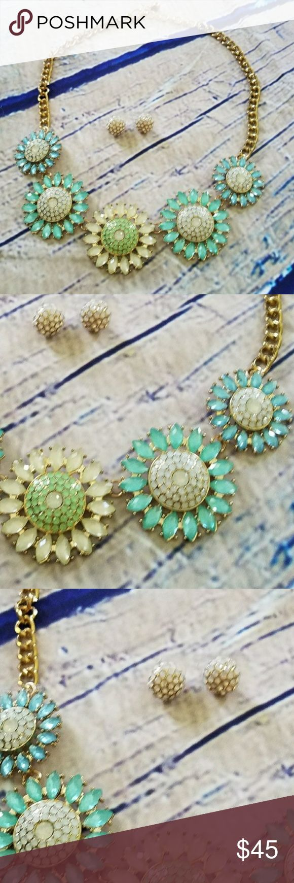 Flower Statement Necklace and earing set Flower Statement Necklace. New without tags. Never worn. Light blue hues mixed with off white and pale green to create the flowers of this outfit maker statement necklace. Gold hardware. Claps closure. Cluster stud matching earrings. Jewelry Necklaces