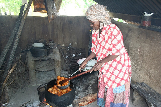 "Village Woman frying Magwinya (fat cakes) . Precious Ramotswe, leading character of  Alexander McCall Smith's The No. 1 Ladies' Detective Agency series is ""writing"" a cookbook to share her favourite recipes for Botswanan dishes."